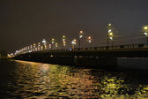 Illuminated bridge in Riga — Stock Photo