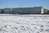 Winter Palace and frozen Neva River — Stock Photo