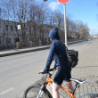 Girl cyclist on street of St.Petersburg — Stock Photo #24401879