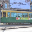 Green tram in the capital of Finland, Helsinki - Stock Photo