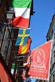 Flags on the street in Stockholm — Stockfoto