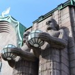 Statues adorn the main railway station, Helsinki - Stock Photo