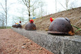 Old steel helmet on war memorial — Stock Photo