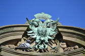 Coat of arms in the form a two-headed eagle — Stock Photo