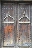 Aged wood door in Girona — Stock Photo