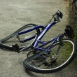 Deformated bicycle after accident - Stock Photo