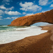 Natural arch on the beach Legzira. Morocco — Stock Photo