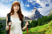 Young woman hiking in Swiss Alps — Stock Photo