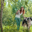 Young woman with the Dog outdoor — Stock Photo