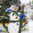 Snowman near Christmas tree — Stock Photo
