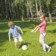 Children playing football — Stock Photo #14125518