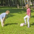 Children playing with ball — Stock Photo #14449299