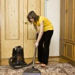 Woman with vacuum cleaner — Stock Photo
