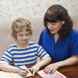 Mother and child preparing lessons — Stock Photo