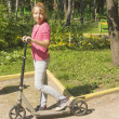 Girl on scooter — Stockfoto #15877669