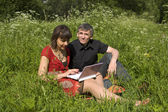 Couple with notebook — Stock Photo