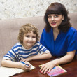 Stock Photo: Mother and child preparing lessons