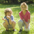 Boy and girl on grass — Stock Photo #16915659
