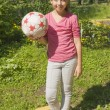 Girl standing with ball — Stock Photo