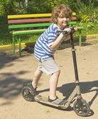 Child on scooter — Stock Photo