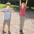 Стоковое фото: Boy and girl making physical excersises