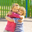 Stock Photo: Boy and girl embracing