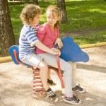 Boy and girl on swing — Stock Photo #20537303