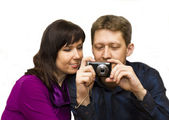 Young man and woman with photocamera — Stock Photo