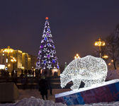 Electric bear and Christmas tree — Stock Photo