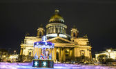 Christmas carousel and cathedral of Saint Isaac, St. Petersburg — Stock Photo