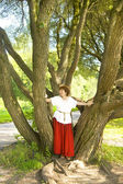 Woman near big willow trees — Stock Photo