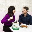 Wife feeds husband — Stock Photo