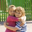 Children embracing — Stockfoto