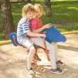 Children on swing — Stock Photo #33968217