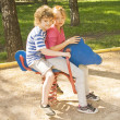 Children on swing — Stockfoto