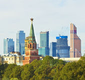 Moscow, Kremlin tower and skyscrapers — Stock Photo