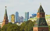 Moscow, Kremlin towers and modern buildings — Stock Photo