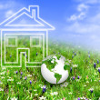 Stock Photo: New house imagination on green meadow