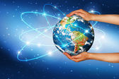 Globe on her hands, South and North America — Stockfoto