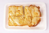 Toast bread with butter and sweetened condensed milk — Stock Photo