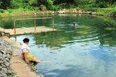 Thai Senior Relaxing Outdoor Thermal Pool — Stock Photo