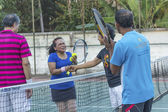 SURAT THANI, THAILAND - MARCH 1:Unidentified Thai senior tennis players shakes the hands after winning the match on March 1, 2014 in Chaiya tennis court, Surat Thani, Thailand. — Stock Photo