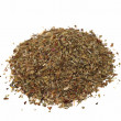 Macro pile of dried basil spice isolated on white background — Stock Photo