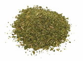 Pile chopped dried parsley leaves isolated on white background — Stock Photo