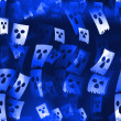 Stock Photo: Blue skulls background