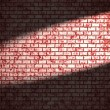 Red brick wall  with spotlight — Stock Photo