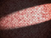 Red brick wall with spotlight — 图库照片