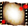 Royalty-Free Stock Photo: Blank old film roll with drops of blood background