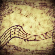 Music notes on old paper sheet background — Photo