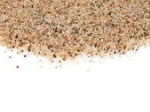Macro pile desert sand isolated on white background (Mediterranean sand) — Stock Photo
